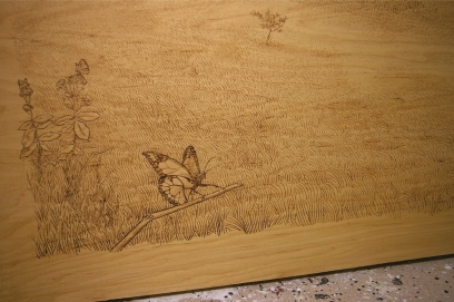 Pyrography on headboard.